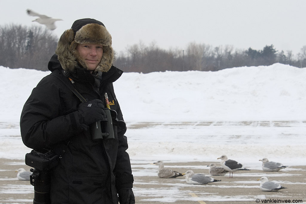 Me with an adult Slaty-backed Gull in the background. Lake County Fairground, Libertyville, Illinois, USA. 14 February 2014.